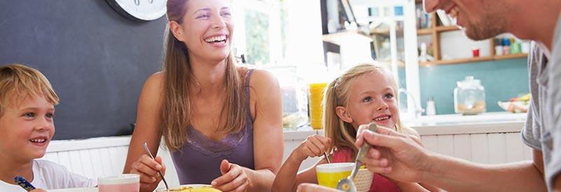 family enjoys breakfast in their new home
