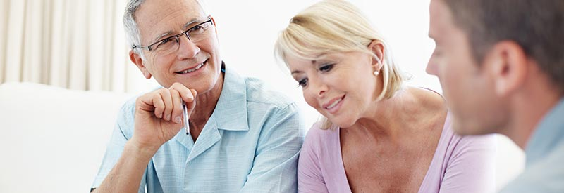 a couple discusses home options with a real estate agent