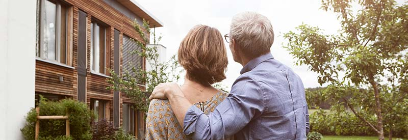 husband and wife admiring a home for sale